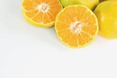 Slices of orange, tangerine fruit. Slices of orange, tangerine fruit isolated on white background Royalty Free Stock Photography