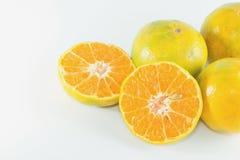 Slices of orange, tangerine fruit. Slices of orange, tangerine fruit isolated on white background Royalty Free Stock Images