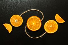 Slices of oranges on a black background stock photo