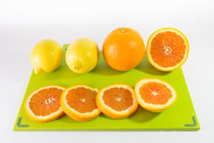 Slices Of Oranges And Lemon. On a Chopping Board royalty free stock image