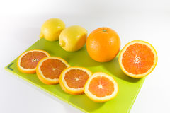 Slices Of Oranges And Lemon. On a Chopping Board royalty free stock photography