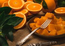 Slices of oranges on a plate stock photography