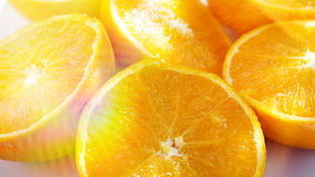 Slices of oranges in the sunlight stock photos