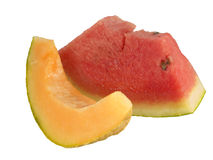 Slices of organic fruit rockmelon and watermelon Royalty Free Stock Images