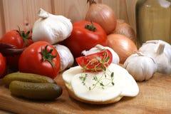 Slices organic mozzarella cheese on bread. Some slices organic mozzarella cheese on bread royalty free stock photos