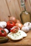 Slices organic mozzarella cheese on bread. Some slices organic mozzarella cheese on bread stock image