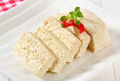 Slices of organic tofu Stock Images