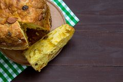 Slices of panettone with fruits and nuts, italian Christmas dessert stock image