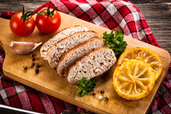 Slices of paté on a cutting board with seasonings Royalty Free Stock Images