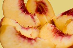 Slices of peach. Isolated, focus on center Stock Photography
