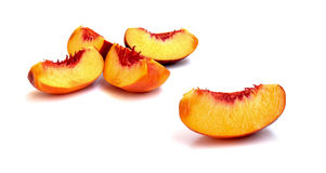 Slices of a peach fruit. Five slices of a a freshly cut peach fruit Royalty Free Stock Photo
