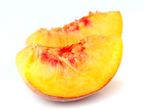 Slices of peach on white background Stock Photo