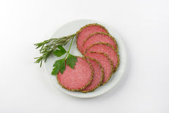 Slices of pepper salami Stock Photography