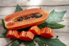 Slices piece of sweet papaya fruit. stock photo