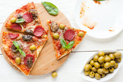 Slices of pizza and an empty dish Royalty Free Stock Image