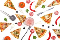 Slices of pizza, ingredients and cutlery on a white background. Top view royalty free stock images