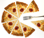 Slices of pizza. And one fork like a business graph Royalty Free Stock Photography