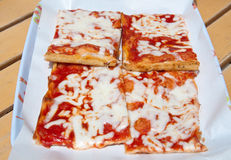 Slices of pizza topped with tomato, mozzarella and olive oil Stock Images