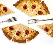 Slices of pizza. With two forks Royalty Free Stock Photo