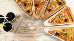 Slices of pizza on wooden plates. Party concept. stock video