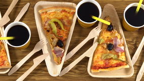 Slices of pizza on wooden plates. Party concept. stock video footage