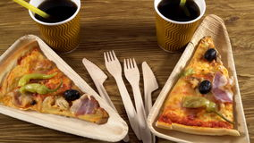 Slices of pizza on wooden plates. Party concept. stock footage