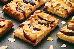 Slices of plum pie on black background. royalty free stock photos
