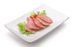 Slices of pork balyk on the plate Royalty Free Stock Photography