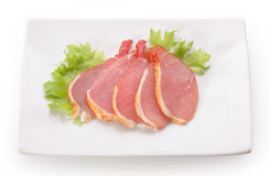 Slices of pork balyk on the plate Royalty Free Stock Photo