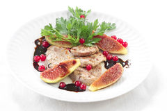 Slices of pork with figs and berry fruit Stock Images