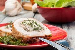 Slices of pork roast stuffed with mushrooms Stock Photography