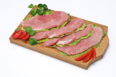 Slices of pork. On wooden board Royalty Free Stock Photography