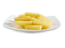 Slices potato on the white dish isolated  Royalty Free Stock Photo