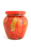 Slices of preserved bulgarian pepper  in glass jar Stock Images