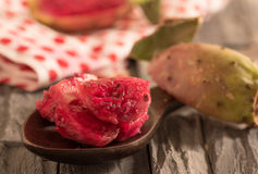 Slices of prickly pear cactus on wooden spoon. Royalty Free Stock Image