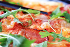 Slices of prosciutto ham on pizza Royalty Free Stock Photos