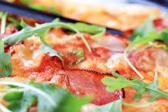 Slices of prosciutto on pizza Stock Image