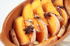 Slices of pumpkin baked with dittany, cardamom Stock Photos