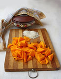 Slices of pumpkin on the board for cooking porridge in bitter go Stock Photo