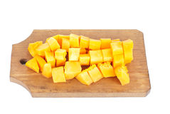 Slices of pumpkin and cutting board,isolated Royalty Free Stock Photography