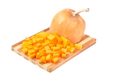 Slices of pumpkin on cutting board Stock Images