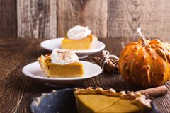 Slices of pumpkin pie in cast iron skillet Stock Photo