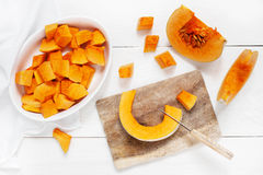Slices pumpkin on the white wooden table Royalty Free Stock Photography
