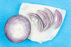 Slices of purple red onion. Fresh red onion stock image