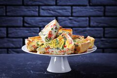 Slices of quiche with salmon asparagus cheese