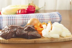 Slices of raw beef liver. Liver slices of raw beef with vegetables Stock Images