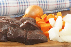 Slices of raw beef liver. Liver slices of raw beef with vegetables Stock Photography