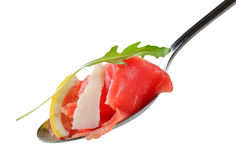 Slices of raw beef on spoon. Thin slices of raw beef on spoon Royalty Free Stock Photography