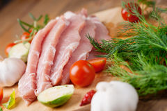 Slices of raw pork meat and vegetables. Photography of a slices of raw pork meat and vegetables Stock Images