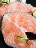 Slices of raw salmon Stock Photos